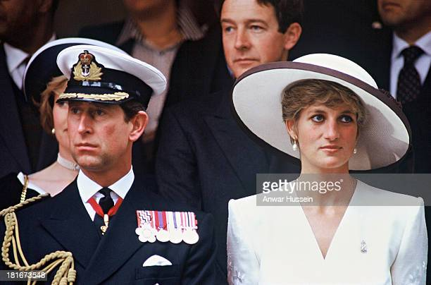 Prince Charles, Prince of Wales and Diana, Princess of Wales, wearing a white embroidered dress designed by Catherine Walker, a white hat designed by...