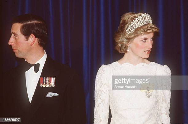 Prince Charles Prince of Wales and Diana Princess of Wales wearing a white Murray Arbeid dress and Queen Marys diamond and pearl tiara attend a...