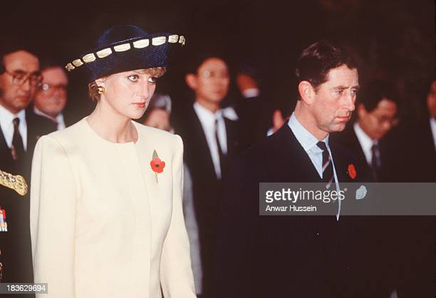 Prince Charles Prince of Wales and Diana Princess of Wales look sad as they arrive in Seoul for the start of their visit to South Korea on November...