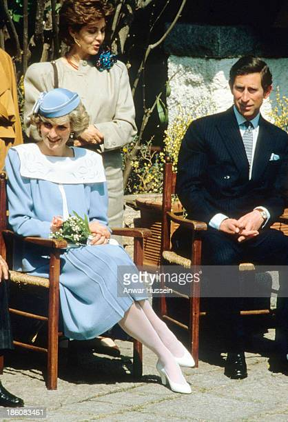 Diana Princess of Wales wearing a blue Jan van Velden suit and a john Boyd hat and Prince Charles Prince of Wales visit Sardinia on April 30 1985 in...