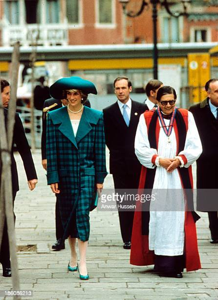 Diana Princess of Wales wearing a green coat designed by the Emanuels and Prince Charles Prince of Wales walk through Venice on May 05 1985 in Venice...