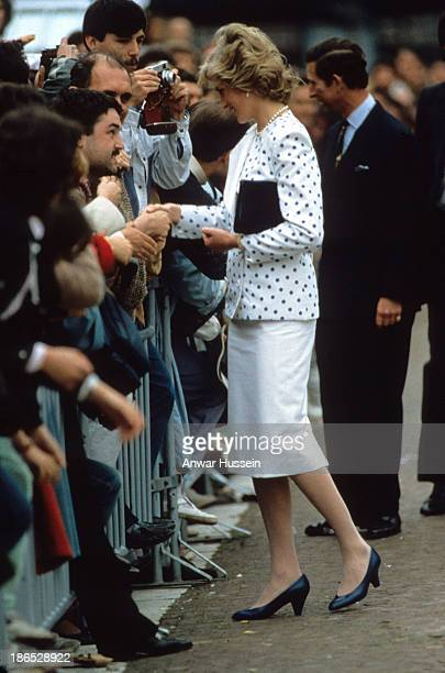 Diana Princess of Wales wearing a Jan Vn Velden outfit and Prince Charles Prince of Wales greet the public during a visit to Venice on May 04 1985 in...