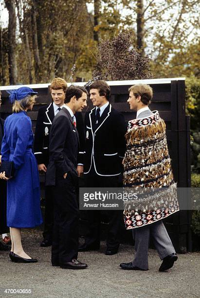 Prince Charles Prince of Wales and Diana Princess of Wales visit Prince Edward wearing a kiwi feather cloak at the Wanganui Collegiate School where...