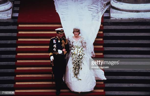 Prince Charles, Prince of Wales and Diana, Princess of Wales, wearing a wedding dress designed by David and Elizabeth Emanuel and the Spencer family...