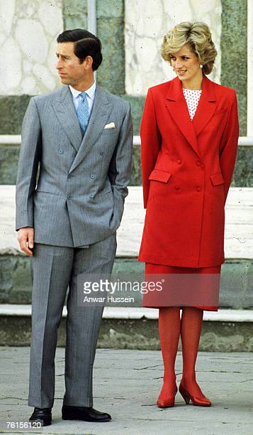 Diana Princess of Wales and Prince Charles visit a church on April 23 1985 in Florence Italy during the Royal Tour of Italy Diana wore a red suit by...