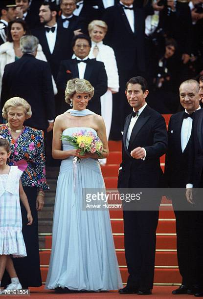 Prince Charles, Prince of Wales and Diana, Princess of Wales, wearing a pale blue silk chiffon strapless dress with a matching chiffon stole designed...