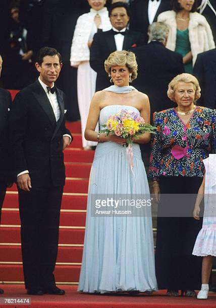 Prince Charles, Prince of Wales and Diana, Princess of Wales, wearing a pale blue silk chiffon strapless dress with a matching chiffon stole designed...