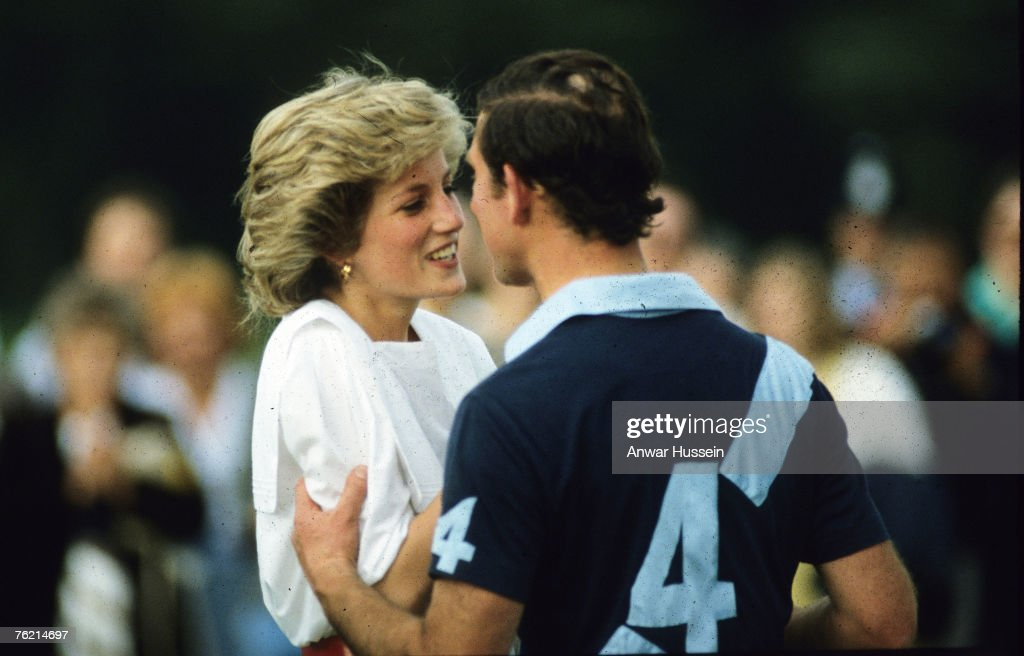 Prince Charles and Princess Diana kiss during a polo match at Cirencester Park, Enlgand in July, 1985.