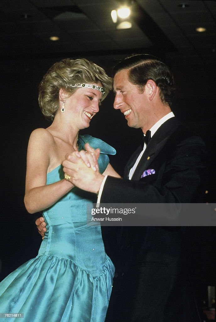 A 1985 photo of Princess Diana, Princess of Wales, in a David Emanuel dress and Prince Charles, Prince of Wales, dancing in Melbourne. British designer Emanuel designed the princess's wedding dress.