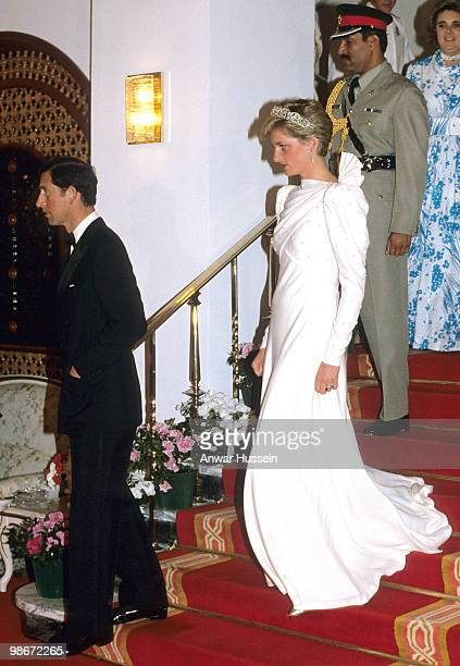 Diana Princess of Wales wears the Spencer Tiara and a dress designed by the Emanuels at a State Banquet with Prince Charles Prince of Wales on...