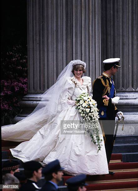 Diana Princess of Wales wearing an Emanuel wedding dress leaves St Paul's Cathedral with Prince Charles Prince of Wales at their wedding on 29 July...