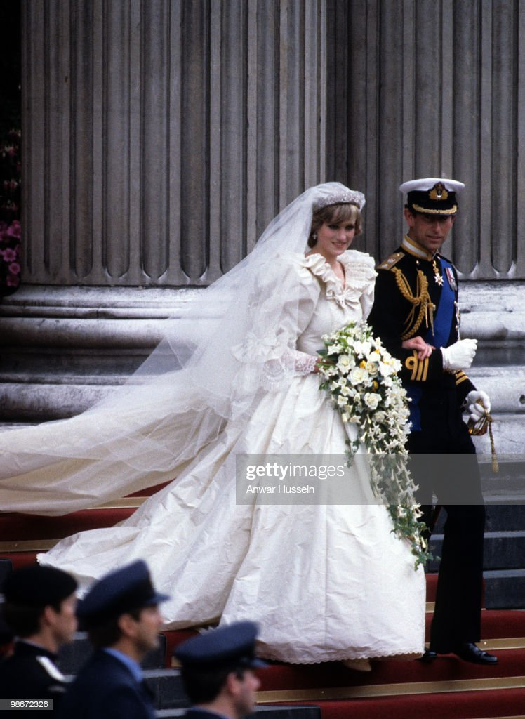 Diana, Princess of Wales, wearing an Emanuel wedding dress, leaves St. Paul's Cathedral with Prince Charles, Prince of Wales following their wedding on 29 July, 1981 in London, England.