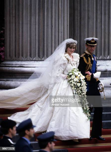 Diana Princess of Wales wearing an Emanuel wedding dress leaves St Paul's Cathedral with Prince Charles Prince of Wales following their wedding on 29...