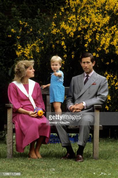 Prince Charles, Prince of Wales and Diana, Princess of Wales, while 6 months pregnant with Prince Harry and wearing a pink sailor style dress with a...