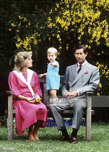 Prince Charles and Princess Diana pose with their son Prince William for his second birthday in their garden at their Kensington Palace home June 12...