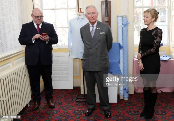 Prince Charles Prince of Wales and Emma Willis listen to Karl Tearney former service member and participant in 'Style for Soldier' reading poetry...
