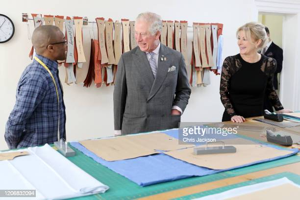 Prince Charles Prince of Wales and Emma Willis talk to an employee in the cutting room during his visit at the Emma Willis LTD factory on February 17...