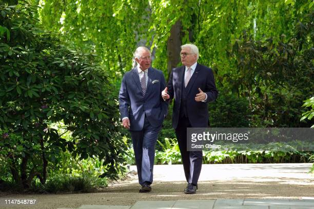 Prince Charles Prince of Wales and German President FrankWalter Steinmeier walk through the gardens at Castle Bellevue on May 07 2019 in Berlin...