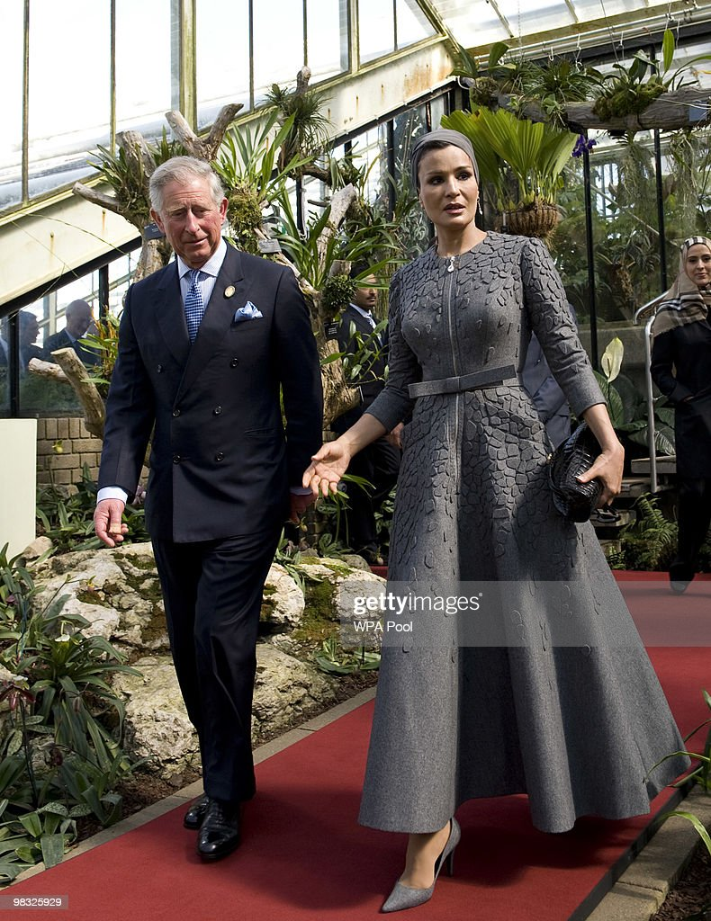 Prince Charles, Prince of Wales (L) and Her Highness Sheikha Mozah bint Nasser Al Missned, Chairperson of Qatar Foundation for Education, Science and Community Development, attend the official opening of the Qur'anic Garden Exhibition at the Royal Botanic Gardens on April 8, 2010 in Surrey, England.