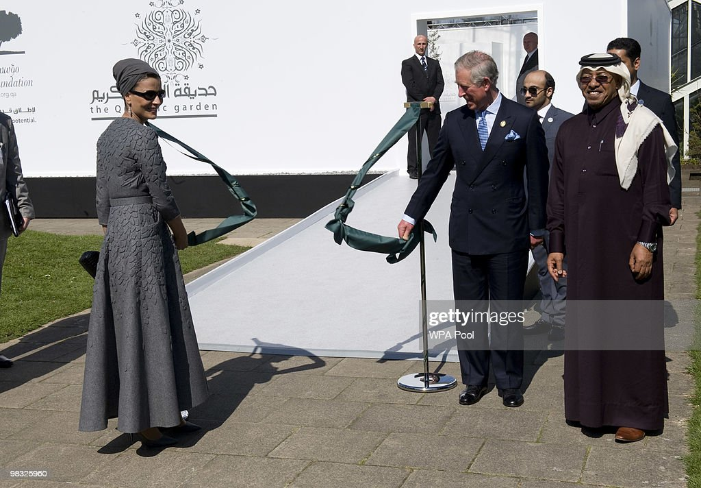 Prince Charles, Prince of Wales (2R) and Her Highness Sheikha Mozah bint Nasser Al Missned (L), Chairperson of Qatar Foundation for Education, Science and Community Development, attend the official opening of the Qur'anic Garden Exhibition at the Royal Botanic Gardens on April 8, 2010 in Surrey, England.