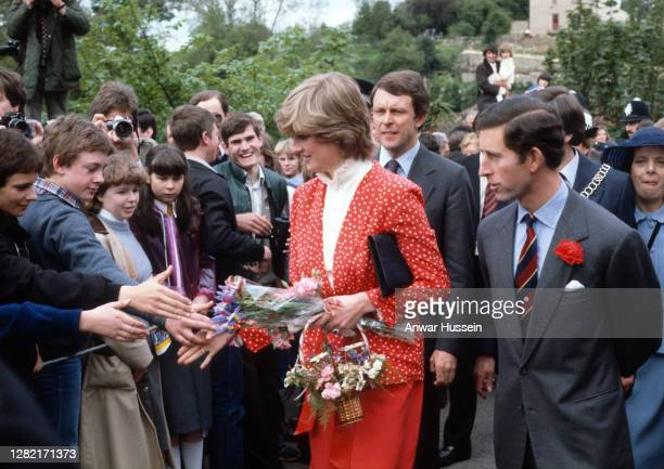 Prince Charles, Prince of Wales and his fiance Lady Diana Spencer, wearing a red and white polka dot suit designed by Jasper Conran, attend their...