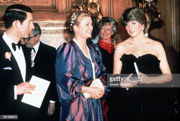 Prince Charles, Prince of Wales and his fiance, Lady Diana Spencer, wearing a strapless black taffeta dress designed by David and Elizabeth Emanuel,...