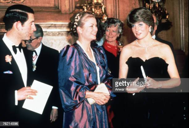 Lady Diana Spencer later to become The Princess of Wales wears a revealing Emanuel black dress when she attends her first official engagement with...