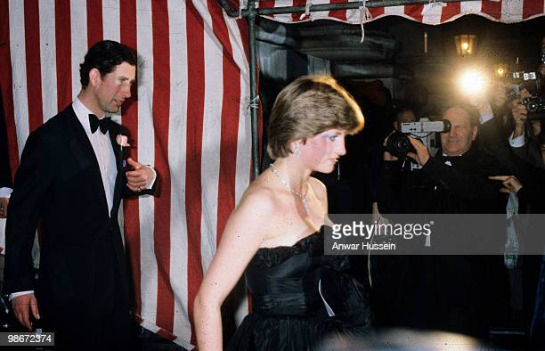 Lady Diana Spencer later to become Diana Princess of Wales wears a revealing Emanuel black dress as she attends her first official engagement with...