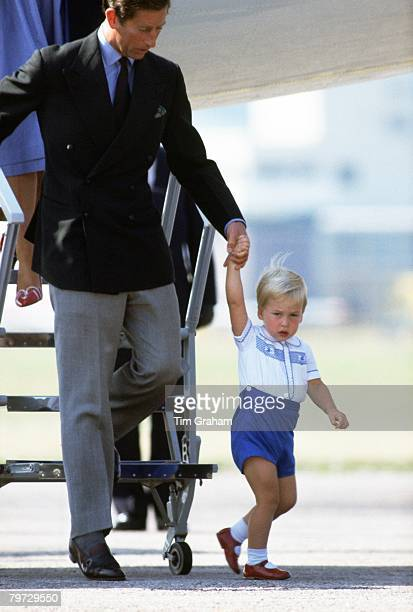 Prince Charles Prince of Wales and his son Prince William prepare to disembark a Royal Flight plane at Aberdeen Airport at the start of their summer...
