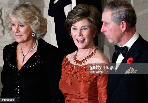 Prince Charles Prince of Wales and his wife Camilla Duchess of Cornwall are greeted by US first lady Laura as they pose for photographers at the...