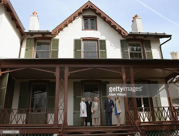 Prince Charles Prince of Wales and his wife Camilla Duchess of Cornwall stand with Erin Carlson Mast Director of Lincoln Cottage Lester G Fant III...