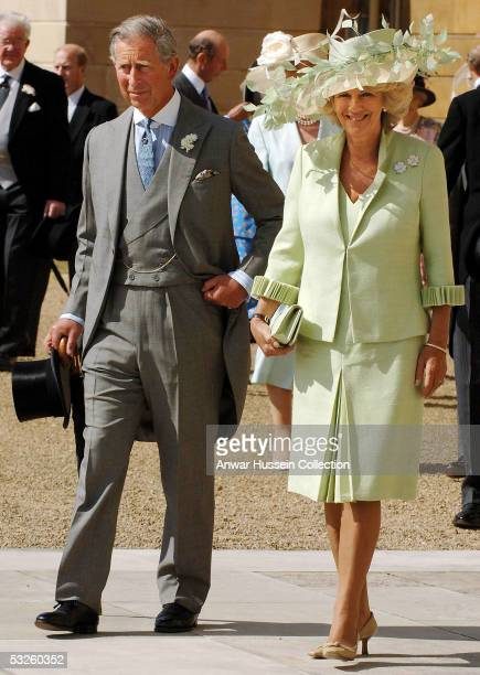 Prince Charles, Prince of Wales, and his wife Camilla, Duchess Of Cornwall, attend the Buckingham Palace garden party July 19, 2005 in London. This...