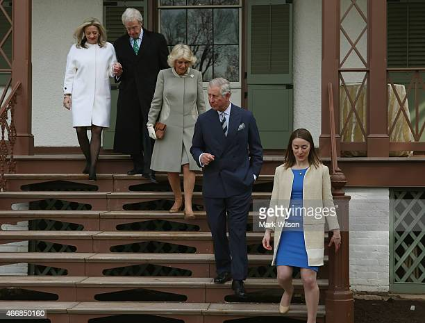 Prince Charles Prince of Wales and his wife Camilla Duchess of Cornwall walk with Erin Carlson Mast Director of Lincoln Cottage Lester G Fant III and...