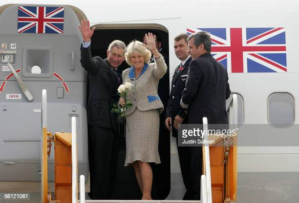 Prince Charles Prince of Wales and his wife Camilla Duchess of Cornwall wave as they prepare to board their plane at the San Francisco Police...