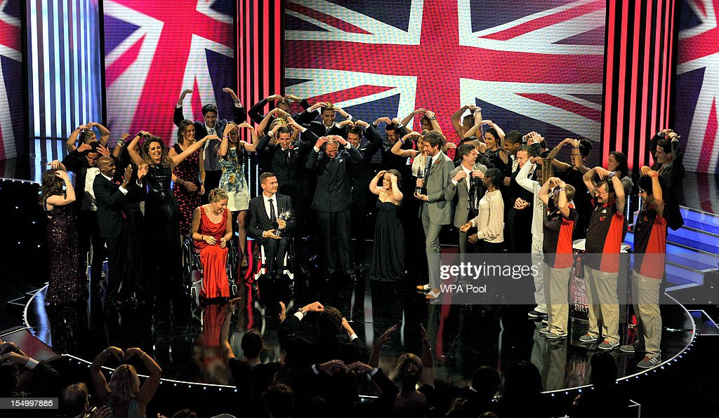 Prince Charles, Prince of Wales and members of the Olympic and Paralympic Team GB do the 'Mobot' at the Pride Of Britain awards at the Grosvenor House Hotel on October 29, 2012 in London, England.