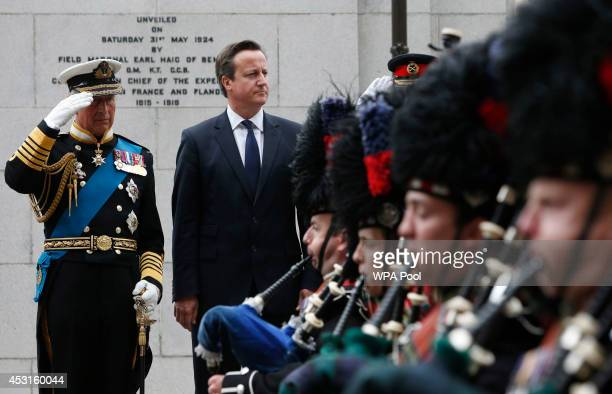 Prince Charles Prince Of Wales and Prime Minister David Cameron take the Salute at a wreathlaying ceremony at the cenotaph in Glasgow to commemorate...