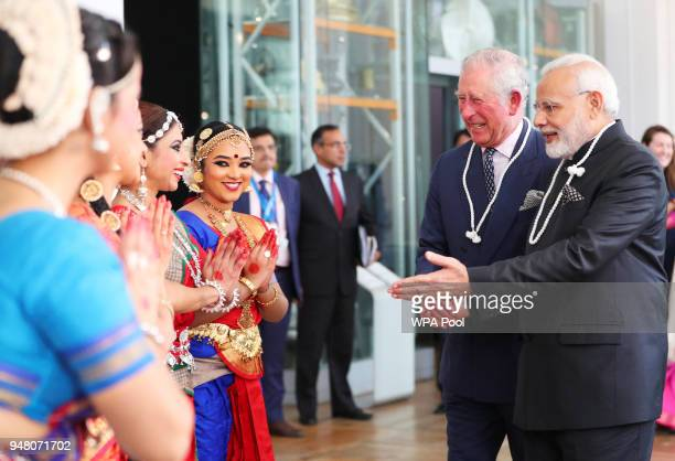 Prince Charles Prince of Wales and Prime Minister of India Narendra Modi speak to dancers during their visit to the Science Museum on April 18 2018...