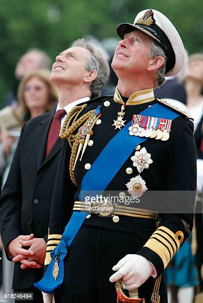 Prince Charles Prince of Wales and Prime Minister Tony Blair watch aircraft from the Royal Air Force take part in a flypast after the Falklands...