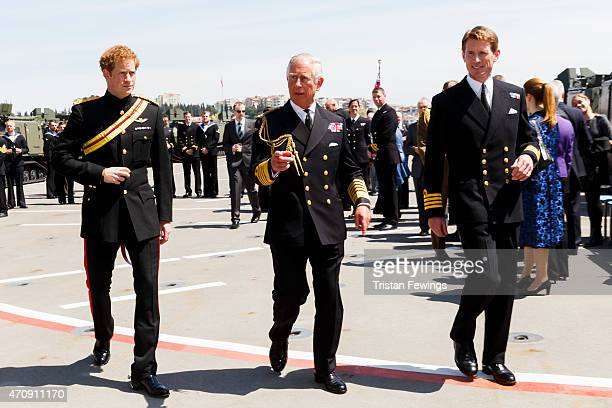 Prince Charles Prince of Wales and Prince Harry attend a reception on HMS Bulwark where they met Commanding Officer Captain Nick CookePriest and...