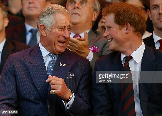 Prince Charles Prince of Wales and Prince Harry laugh during the opening ceremony of the Invictus Games at the Queen Elizabeth Park on September 10...