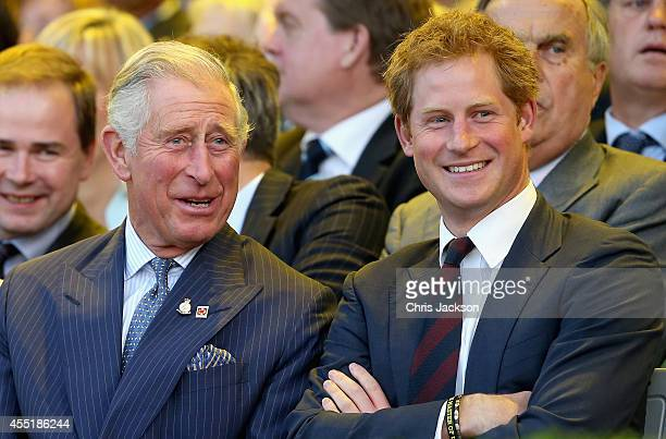 Prince Charles Prince of Wales and Prince Harry laugh during the Invictus Games Opening Ceremony on September 10 2014 in London England The...