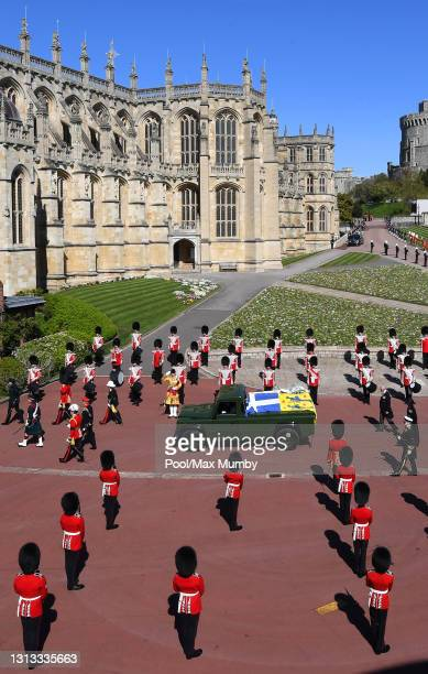 Prince Charles, Prince of Wales and Princess Anne, Princess Royal follow Prince Philip, Duke of Edinburgh's coffin as it is carried on a specially...