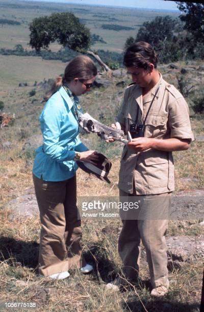 Prince Charles Prince of Wales and Princess Anne study an old bone on safari in the Masai Game Reserve on February 15 1971 in Nairobi Kenya