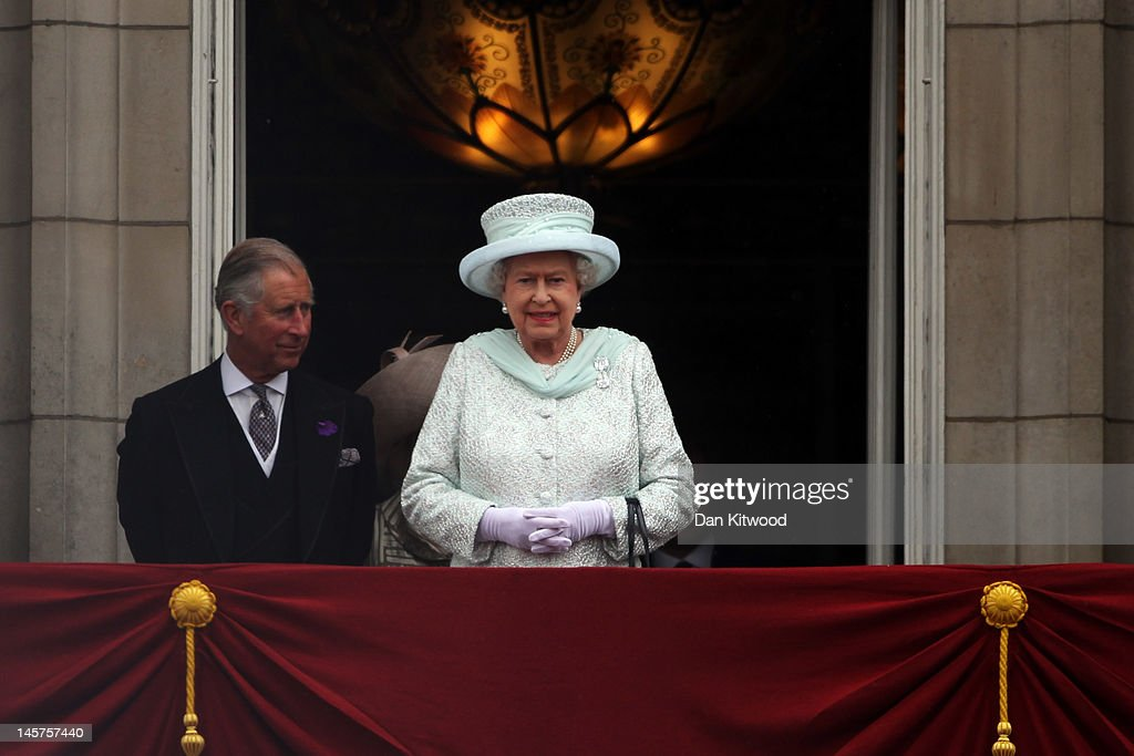 Prince Charles, Prince of Wales and Queen Elizabeth II look over the crowds from Buckingham Palace during the Diamond Jubilee carriage procession after the service of thanksgiving at St.Paul's Cathedral on the Mall on June 5, 2012 in London, England. For only the second time in its history the UK celebrates the Diamond Jubilee of a monarch. Her Majesty Queen Elizabeth II celebrates the 60th anniversary of her ascension to the throne. Thousands of wellwishers from around the world have flocked to London to witness the spectacle of the weekend's celebrations.