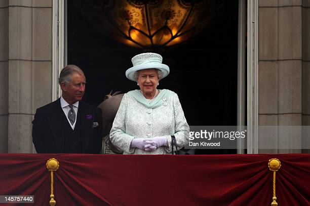 Prince Charles Prince of Wales and Queen Elizabeth II look over the crowds from Buckingham Palace during the Diamond Jubilee carriage procession...