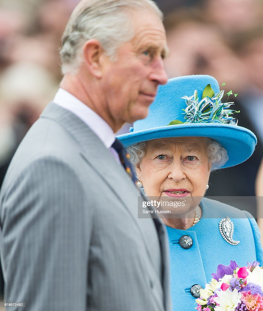 Prince Charles, Prince of Wales and Queen Elizabeth II tour Queen Mother Square on October 27, 2016 in Poundbury, Dorset.