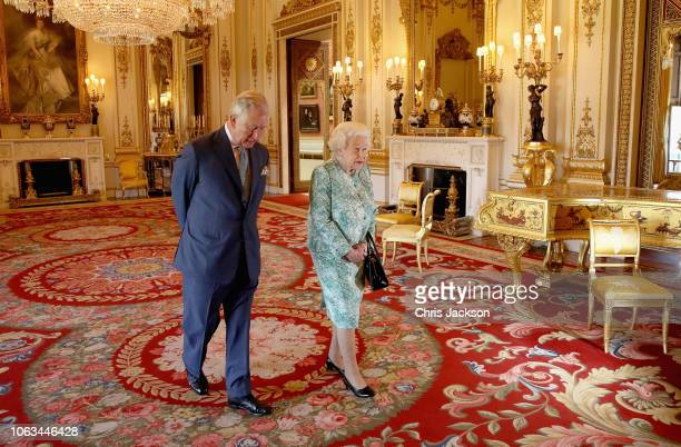 Prince Charles, Prince of Wales and Queen Elizabeth II walk out ahead of the formal opening of the Commonwealth Heads of Government Meeting , in the...