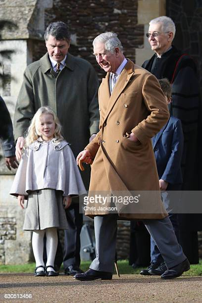 Prince Charles Prince of Wales and Savannah Phillips attend a Christmas Day church service at Sandringham on December 25 2016 in King's Lynn England