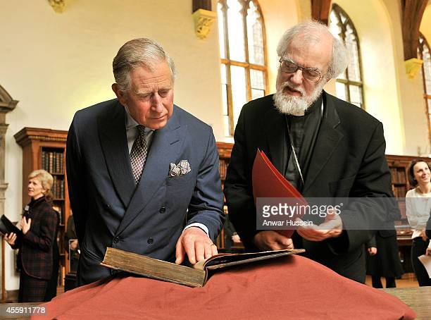 Prince Charles Prince of Wales and the Archbishop of Canterbury Dr Rowan Williams study a copy of the book of Common Prayer produced in 1662 during...