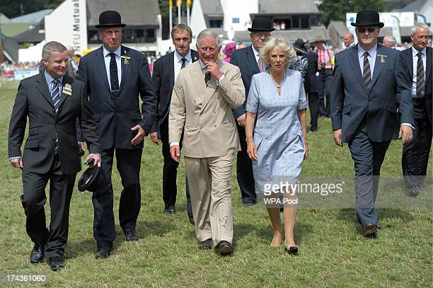 Prince Charles, Prince of Wales and the Camilla, Duchess of Cornwall walks in the Main Ring at the Royal Welsh Show in Llanelwedd on July 24, 2013 in...